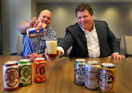 Waltham--4/27/16- Dale Katechis(left) founder of Oskar Blues and Fireman Capital managing partner, Dan Fireman with a sampling of beers brewed by Katechis' s company. Boston Globe staff Photo by John Tlumacki (business)